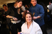 Model Ashley Graham prepares backstage for TRESemme at Prabal Gurung during NYFW on February 10, 2019 in New York City.