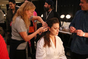 Stylist Odile Gilbert prepares model Ashley Graham backstage for TRESemme at Prabal Gurung during NYFW on February 10, 2019 in New York City.