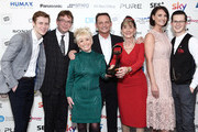 June Brown (third right) with her Special Award and (L-R) Jamie Borthwick, Adam Woodyatt, Barbara Windsor, Perry Fenwick, Emma Barton and Harry Reid during the TRIC Awards 2017 at the Grosvenor House Hotel on March 14, 2017 in London, England.