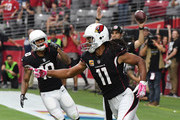 Larry Fitzgerald #11 of the Arizona Cardinals celebrates an 11 yard touchdown pass from Carson Palmer #3 during the second quarter against the Tampa Bay Buccaneers at University of Phoenix Stadium on October 15, 2017 in Glendale, Arizona.
