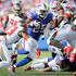 Lesean Mccoy Photos - LeSean McCoy #25 of the Buffalo Bills runs the ball as he is surrounded by Tampa Bay Buccaneers defenders on October 22, 2017 at New Era Field in Orchard Park, New York. - Tampa Bay Buccaneers vBuffalo Bills