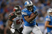 Reggie Bush #21 of the Detroit Lions looks to avoid the tackle by Danny Lansanah #51 of the Tampa Bay Buccaneers in the third quarter at Ford Field on December 07, 2014 in Detroit, Michigan. The Detroit Lions won the game 34-17.