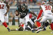 Chris Ivory #33 of the Jacksonville Jaguars runs with the ball against the Tampa Bay Buccaneers during a preseason game on August 20, 2016 at EverBank Field in Jacksonville, Florida.