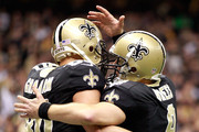 Drew Brees 39 celebrates with Jimmy Graham #80 of the New Orleans Saints after connecting on a touchdown pass against the Tampa Bay Buccaneers at Mercedes-Benz Superdome on December 29, 2013 in New Orleans, Louisiana.