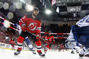 Marcus Johansson #90 of the New Jersey Devils skates against the Tampa Bay Lightning in Game Three of the Eastern Conference First Round during the 2018 NHL Stanley Cup Playoffs at the Prudential Center on April 16, 2018 in Newark, New Jersey. The Devils defeated the Lightning 5-2.