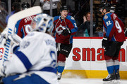 Nathan MacKinnon #29 of the Colorado Avalanche celebrates his third goal of the game against goalie Andrei Vasilevskiy #88 of the Tampa Bay Lightning with teammates Ryan O'Reilly #90 and Gabriel Landeskog #92 of the Colorado Avalanche as his hat trick gave the Avalanche a 4-2 in the second period at Pepsi Center on February 22, 2015 in Denver, Colorado.