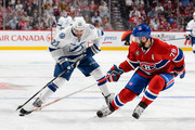 Andrei Markov #79 of the Montreal Canadiens pokes the puck from J.T. Brown #23 of the Tampa Bay Lightning in Game Two of the Eastern Conference Semifinals during the 2015 NHL Stanley Cup Playoffs at the Bell Centre on May 3, 2015 in Montreal, Quebec, Canada.