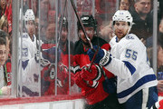 Braydon Coburn #55 of the Tampa Bay Lightning checks Marcus Johansson #90 of the New Jersey Devils into the glass during the first period in Game Three of the Eastern Conference First Round during the 2018 NHL Stanley Cup Playoffs at the Prudential Center on April 16, 2018 in Newark, New Jersey.