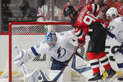 Andrei Vasilevskiy #88 of the Tampa Bay Lightning makes the first period save as Marcus Johansson #90 of the New Jersey Devils looks for the rebound in Game Four of the Eastern Conference First Round during the 2018 NHL Stanley Cup Playoffs at the Prudential Center on April 18, 2018 in Newark, New Jersey.