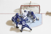Cedric Paquette #13 of the Tampa Bay Lightning scores on Frederik Andersen #31 of the Toronto Maple Leafs as Tyler Bozak #42 and Roman Polak #46 of the Toronto Maple Leafs defend during the second period at the Air Canada Centre on January 2, 2018 in Toronto, Ontario, Canada.