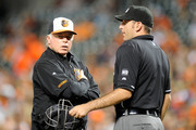 Manager Buck Showalter #26 of the Baltimore Orioles argues a call with home plate umpire Pat Hoberg #31 in the third inning against the Tampa Bay Rays at Oriole Park at Camden Yards on August 26, 2014 in Baltimore, Maryland.