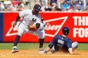 Daniel Nava #7 of the Tampa Bay Rays steals second base in the fifth inning ahead of the tag from Didi Gregorius #18 of the New York Yankees at Yankee Stadium on September 6, 2015 in the Bronx borough of New York City.