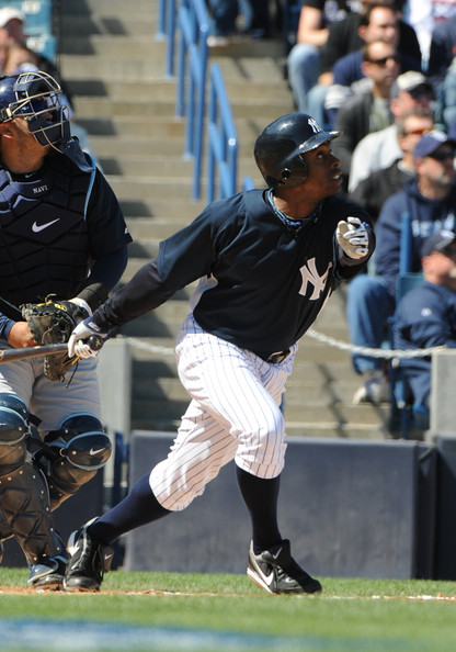 Outfielder Curtis Granderson #14 of the New York Yankees bats against the Tampa Bay Rays March 5, 2010 at the George M. Steinbrenner  Field in Tampa, Florida.