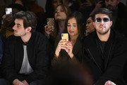 Conor Kennedy, Danielle Bernstein and Andrew Warren attend the Taoray Wang front row during New York Fashion Week: The Shows at Gallery II at Spring Studios on February 9, 2019 in New York City.