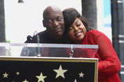 John Singleton and Taraji P. Henson attend a ceremony honoring Taraji P. Henson with a star on The Hollywood Walk of Fame on January 28, 2019 in Hollywood, California.