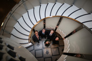 Architect Peter St John (L) stands with (L-R) Lord Browne Chairman Tate, Nicholas Serota, Director Tate, Architect Adam Caruso with Penelope Curtis, Director tate Britain in front in Tate Britain's newly installed staircase on November 18, 2013 in London, England. Architects Peter St John and Adam Caruso have revitalised The Tates entrance, cafe and gallery spaces in a £45 million project.