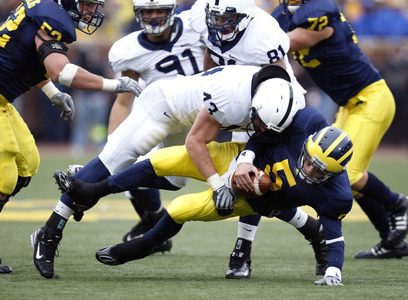 Penn State v Michigan [player,sports gear,sports,helmet,canadian football,gridiron football,football gear,sports equipment,team sport,american football,josh hull,sack,michigan,michigan stadium,ann arbor,penn state,tate forcier 5,michigan wolverines,penn state nittany lions]