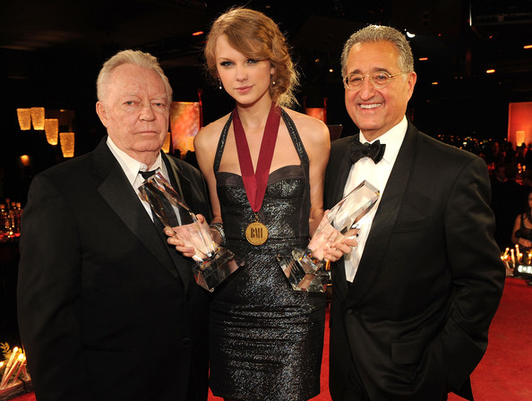 Taylor Swift BMI Icon Billy Sherrill and Taylor Swift with her awards for BMI Songwriter of the Year and Co Writer of BMI Song of the Year and BMI President Del Bryant at the 58th Annual BMI Country Music Awards at BMI on November 9, 2010 in Nashville, Tennessee.