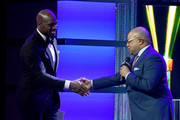 Vernon Davis and Mike Tirico speak onstage during the Team USA Awards at the Duke Ellington School of the Arts on April 26, 2018 in Washington, DC.