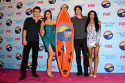 (L-R) Actors Paul Wesley, Nina Dobrev and Ian Somerhalder, winners of Choice Fantasy/Sci-Fi Show award, and singer Kat Graham pose in the press room during the 2012 Teen Choice Awards at Gibson Amphitheatre on July 22, 2012 in Universal City, California.