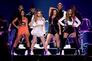 (Front L-R) Singers Leigh-Anne Pinnock, Perrie Edwards, Jesy Nelson, and Jade Thirlwall of Little Mix perform onstage during the Teen Choice Awards 2015 at the USC Galen Center on August 16, 2015 in Los Angeles, California.
