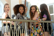 (L-R) Perrie Edwards, Leigh-Anne Pinnock, Jade Thirlwall, and Jesy Nelson of Little Mix attend Teen Vogue's Back-to-School Saturday kick-off event at The Grove on August 9, 2013 in Los Angeles, California.