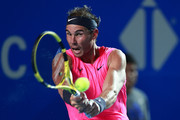 Rafael Nadal of Spain plays a backhand during the singles match against Taylor Fritz of the United States during Day 6 of the ATP Mexican Open at Princess Mundo Imperial on February 29, 2020 in Acapulco, Mexico.