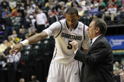 Head coach Tom Izzo of the Michigan State Spartans talks with Adreian Payne against the Iowa Hawkeyes during the first round of the 2011 Big Ten Men's Basketball Tournament at Conseco Fieldhouse on March 10, 2011 in Indianapolis, Indiana.