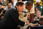 Head coach Tom Izzo of the Michigan State Spartans talks with Adreian Payne #5 against the Wisconsin Badgers during their Semifinal game of the 2012 Big Ten Men's Basketball Conference Tournament at Bankers Life Fieldhouse on March 10, 2012 in Indianapolis, Indiana.