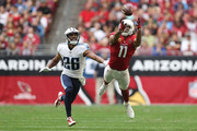 Larry Fitzgerald #11 of the Arizona Cardinals is unable to make the catch in front of Logan Ryan #26 of the Tennessee Titans in the first half at University of Phoenix Stadium on December 10, 2017 in Glendale, Arizona.