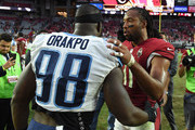 Brian Orakpo #98 of the Tennessee Titans and Larry Fitzgerald #11 of the Arizona Cardinals shake hands after the NFL game at University of Phoenix Stadium on December 10, 2017 in Glendale, Arizona. The Arizona Cardinals won 12 - 7.