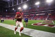 Wide receiver Larry Fitzgerald #11 of the Arizona Cardinals runs off the field following the NFL game against the Tennessee Titans at the University of Phoenix Stadium on December 10, 2017 in Glendale, Arizona. The Cardinals defeated the Titans 12-7.