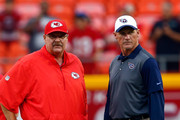 Head coach Andy Reid of the Kansas City Chiefs stands with head coach Ken Whisenhunt of the Tennessee Titans during warm ups prior to the preseason game at Arrowhead Stadium on August 28, 2015 in Kansas City, Missouri.
