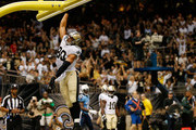Jimmy Graham #80 of the New Orleans Saints celebrates after a touchdown during the first preseason game between the New Orleans Saints and the Tennessee Titans at Mercedes-Benz Superdome on August 15, 2014 in New Orleans, Louisiana.