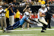 Jimmy Graham #80 of the New Orleans Saints runs the ball as Tommie Campbell #37 of the Tennessee Titans tries to tackle him during a preseason game at the Mercedes-Benz Superdome on August 15, 2014 in New Orleans, Louisiana.