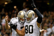 Jimmy Graham #80 of the New Orleans Saints and Luke McCown #7 celebrate after a touchdown during a preseason game between the New Orleans Saints and the Tennessee Titans at Mercedes-Benz Superdome on August 15, 2014 in New Orleans, Louisiana.