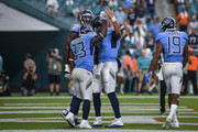 Dion Lewis #33 of the Tennessee Titans celebrating with teammates after rushing in for a touchdown during the fourth quarter against the Miami Dolphins at Hard Rock Stadium on September 9, 2018 in Miami, Florida.