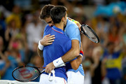 Novak Djokovic and Juan Martin Del Potro Photos Photo