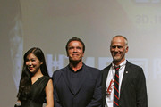 (L to R) Betty Zhou, Arnold Schwarzenegger and Alan Taylor pose for a picture at the event screening of the Terminator Genisys on August 18, 2015 in Shanghai, China.