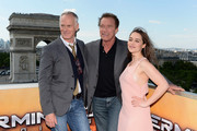 (L-R)  Director Alan Taylor and Actors Arnold Schwarzenegger and Emilia Clarke pose during the France Photocall of 'Terminator Genisys' at the Publicis Champs Elysees on June 19, 2015 in Paris, France.