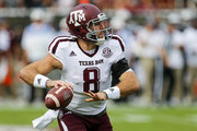Quarterback Trevor Knight #8 of the Texas A&M Aggies rolls out to pass during the first half of an NCAA college football game against the Mississippi State Bulldogs at Davis Wade Stadium on November 5, 2016 in Starkville, Mississippi.