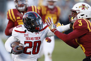 Wide receiver Keke Coutee #20 of the Texas Tech Red Raiders blocks defensive back Mike Johnson #3 of the Iowa State Cyclones as he rushed for yards in the first half of play at Jack Trice Stadium on November 19, 2016 in Ames, Iowa.
