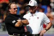 Head coach Tommy Tuberville (R) of the Texas Tech Red Raiders talks with head coach Gary Patterson (L) of the TCU Horned Frogs  at Amon G. Carter Stadium on October 20, 2012 in Fort Worth, Texas.