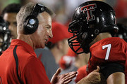 Head coach Tommy Tuberville of the Texas Tech Red Raiders talks with Will Ford #7 during play against the Texas Longhorns at Jones AT&T Stadium on September 18, 2010 in Lubbock, Texas.
