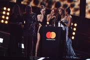 Perrie Edwards, Jesy Nelson, Jade Thirlwall, Leigh-Anne Pinnock of British girl group Little Mix accept the award for a British single for 'Shout Out To My Ex' during the BRIT Awards 2017 ceremony and live show in London on February 22, 2017. / AFP / Justin TALLIS / RESTRICTED TO EDITORIAL USE, TO ILLUSTRATE THE EVENT AS SPECIFIED IN THE CAPTION, NO POSTERS, NO USE IN PUBLICATIONS DEVOTED TO ARTISTS