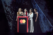 *** EDITORIAL USE ONLY IN RELATION TO THE BRIT AWARDS 2018 *** (L-R) Jesy Nelson, Perrie Edwards, Leigh-Anne Pinnock and Jade Thirlwall of Little Mix speak on stage at The BRIT Awards 2018 held at The O2 Arena on February 21, 2018 in London, England.