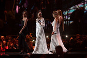 *** EDITORIAL USE ONLY IN RELATION TO THE BRIT AWARDS 2018 *** (R-L) Jesy Nelson, Perrie Edwards, Leigh Anne Pinnock and Jade Thirlwall of Little Mix on stage at The BRIT Awards 2018 held at The O2 Arena on February 21, 2018 in London, England.