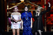 (EDITORIAL USE ONLY) Anne-Marie, Hailee Steinfeld and Courtney Love present the Best Group award during The BRIT Awards 2020 at The O2 Arena on February 18, 2020 in London, England.