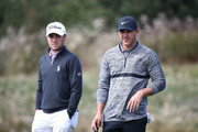 Brooks Koepka of United States talks with Justin Thomas of United States on the 15th hole during the second round of the CJ Cup at the Nine Bridges on October 19, 2018 in Jeju, South Korea.