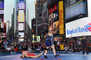 Tervel Dlagnev of the USA celebrates a win over Eduard Bazrov of Russia during the Grapple in the Apple on June 7, 2012 in Times Square in New York, New York.